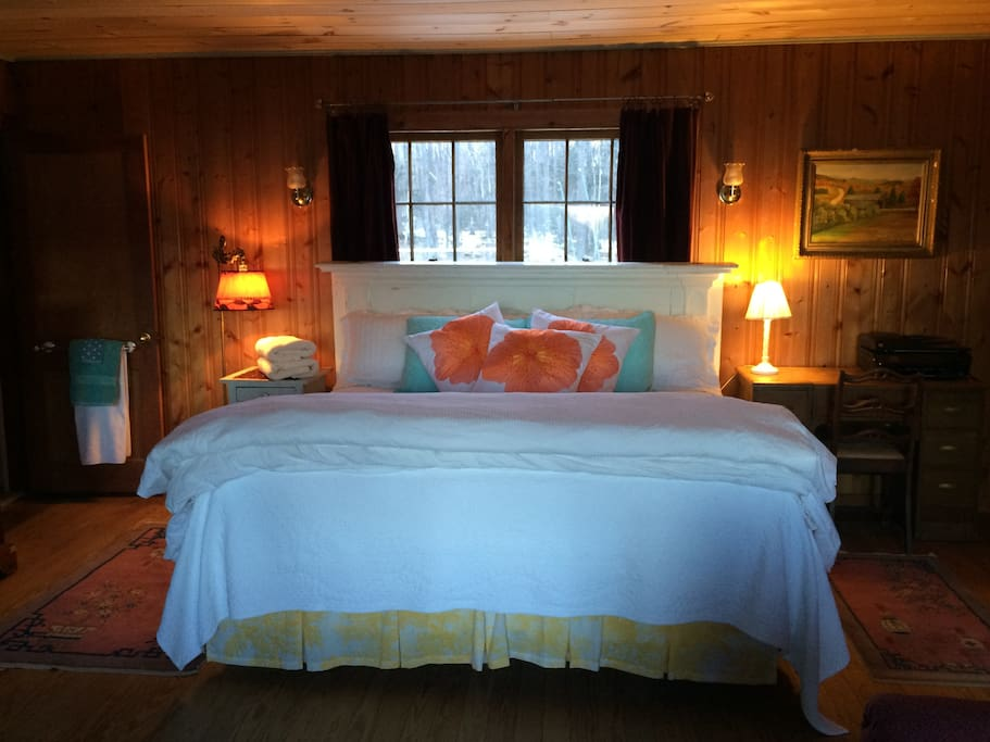 Master bedroom with king bed and private bathroom.