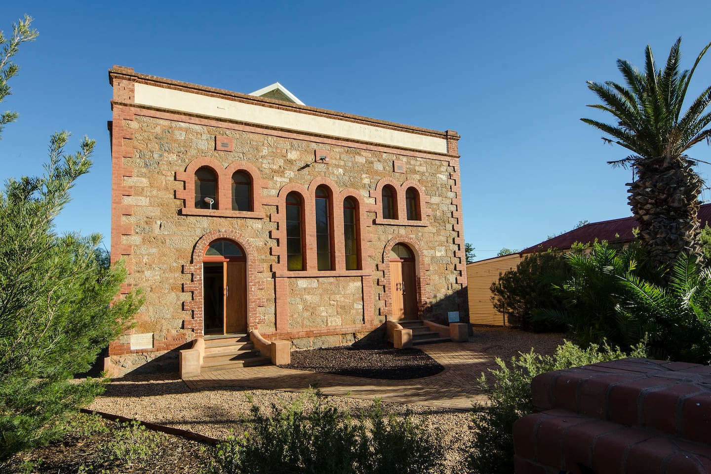 Outback Church Stay. Front facade showing the 1911 inscribed white marble building plaques.