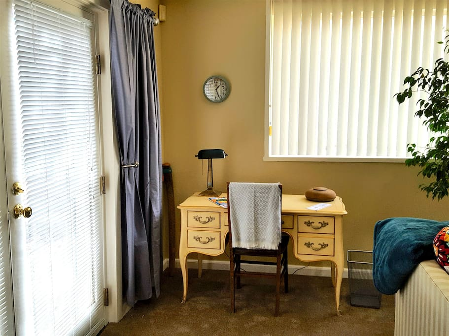Work or stash your briefcase at the desk inside the apartment entrance and under the large living room windows.
