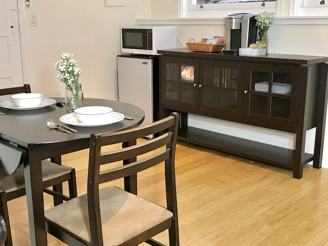 Fully-stocked kitchenette with a Keurig coffee maker, premium snacks, drinks and teas from Whole Foods, and all the cutlery you will need