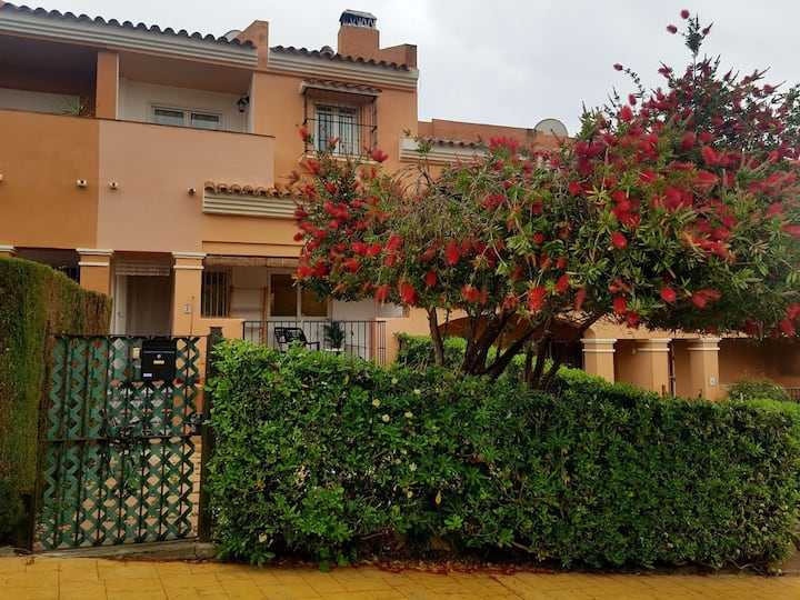 Townhouse with garden in beach and golf resort