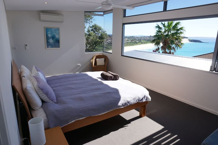 Main ensuite bedroom with views over One-mile beach