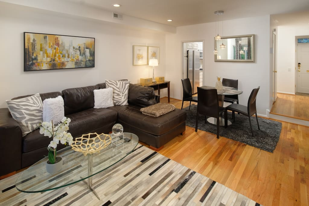 The open floor plan makes this dining room and living room space incredibly inviting.