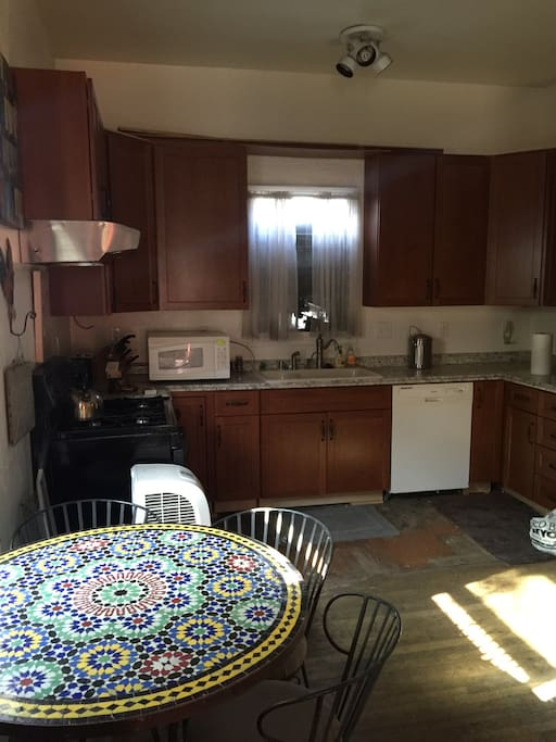 The newly remodeled kitchen features beautiful Shaker cherry cabinets and new appliances.