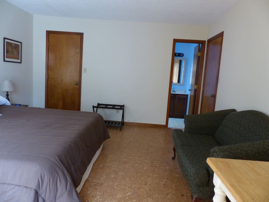 A couch, writing desk, and full bath are part of the King of the Iron Mountain suite.