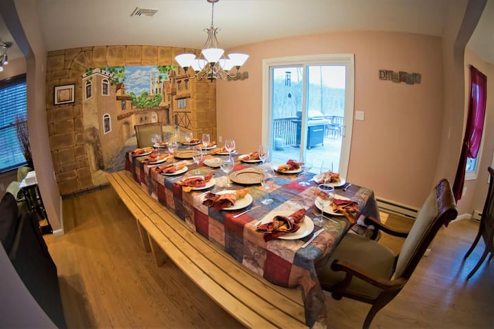 Main Level Large dining room table big enough to fit the whole family!