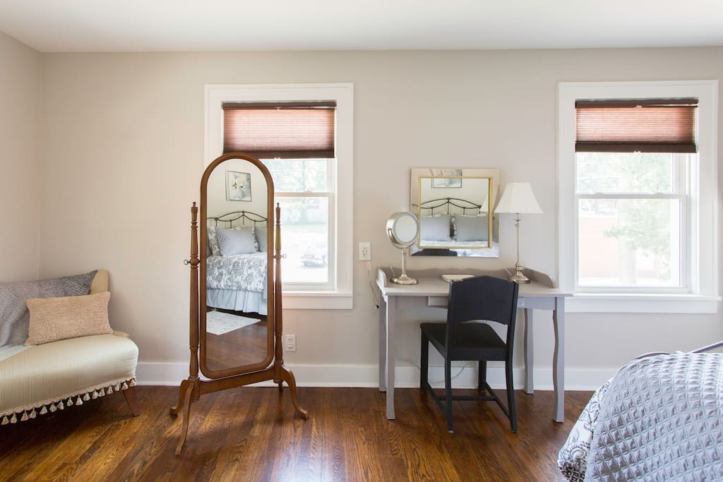 Primp at the master bedroom with a vanity with a makeup mirror and a full length mirror