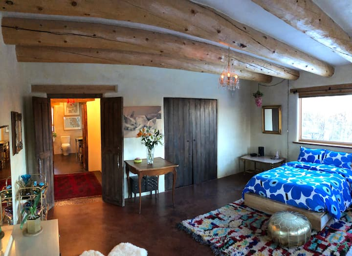 Boutique bedrooms and bath in historic Ranchos