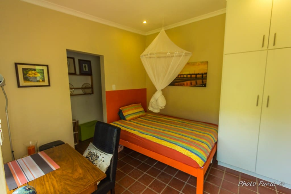 Cosy room furnished with 1.4m bed, mosquitonet, writing desk and huge cupboard