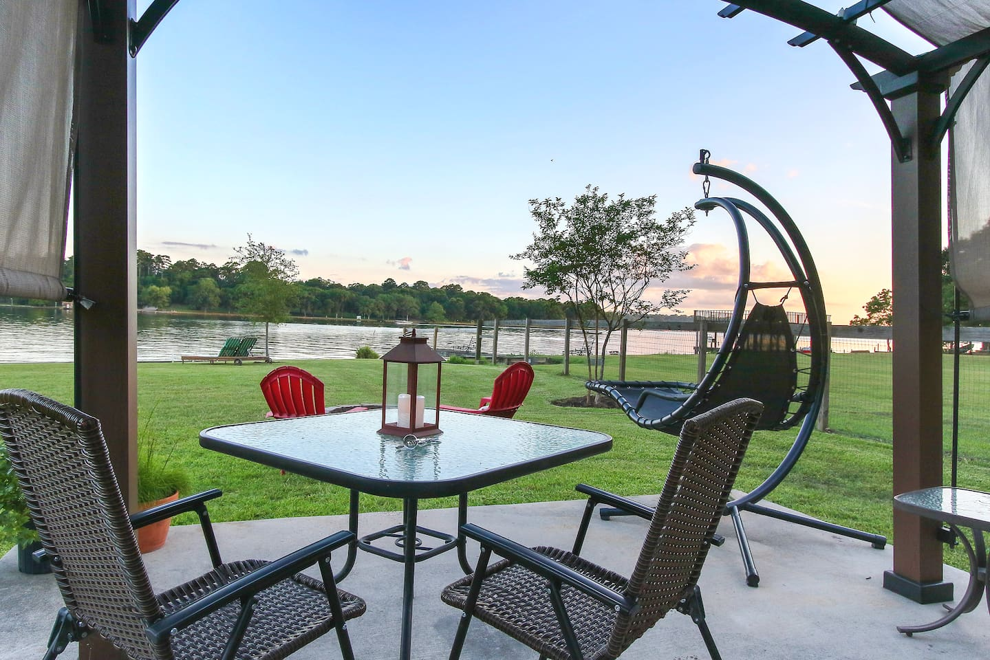 Sit Lakeside as you watch the sunset.  Back patio offers dual loungers, patio table with shade awning & four chairs,  Zero-Gravity Lounge Swing, charcoal grill & a personal fire pit.  This will be your new happy place!
