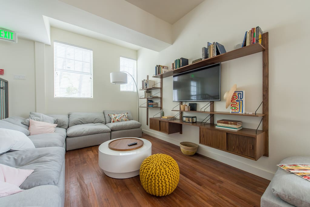 Living Area with loaded bookshelves and smart TV.