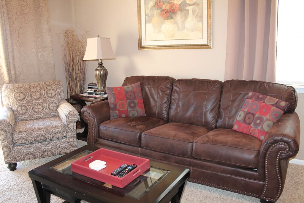 Queen sleeper sofa, accent chair, and matching pillows.