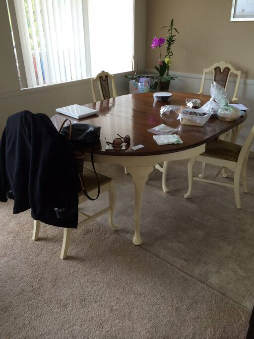 Dining table in a breakfast nook.