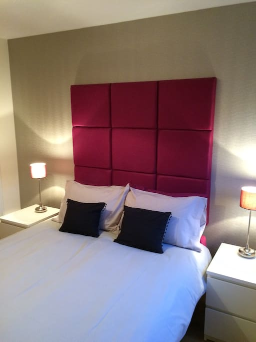 Second bedroom with luxurious headboard, good quality bedding and lovely solid oak flooring