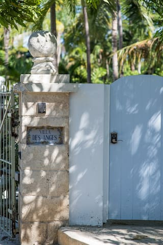 Villa Des Anges Front Gate with remote control auto main gate system as well as private access door to the private road entry.