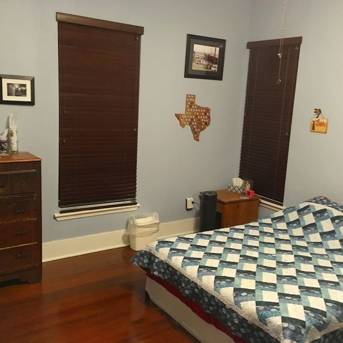 View to the left when you walk in. Queen size bed, bedside table, multiple usb/plug, air purifier, 4 drawer dresser.