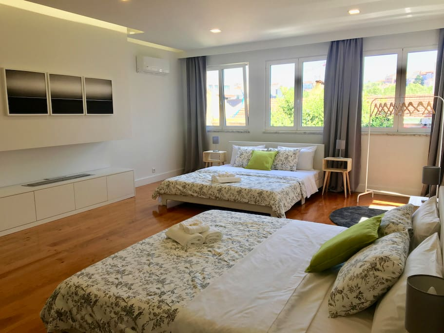 Huge and bright bedroom with kingsize beds and shared bathroom for 4 people.