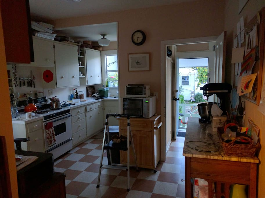 The kitchen, backdoor and laundry room