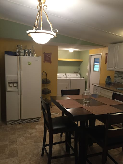 Kitchen with refrigerator and washer and dryer