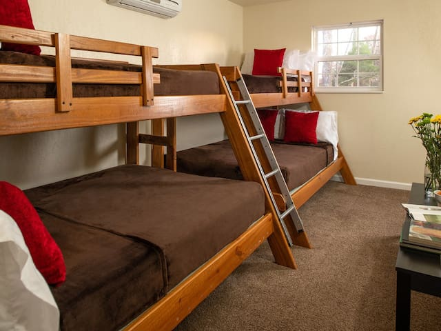 Dogwood chalets third bedroom with two sets of bunk beds with fulls on the bottom and twins on the top. Perfect for the kids and strong enough for the adults.