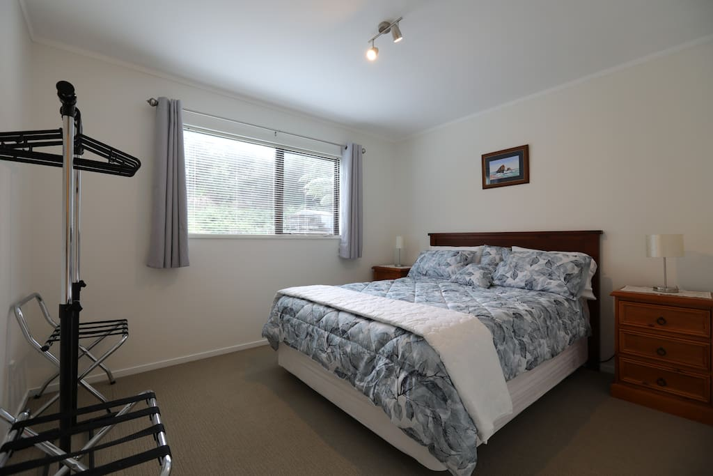 Queen size bed in main bedroom