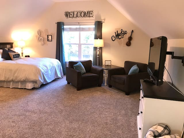 This is the main living space, which has a great view of our wooded front yard and you can see your vehicle as well.