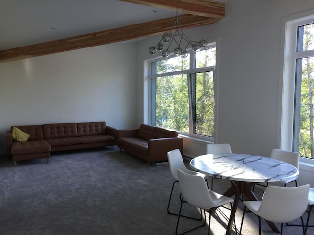 Second floor family and games room has a view of the park and Rocky Mountains