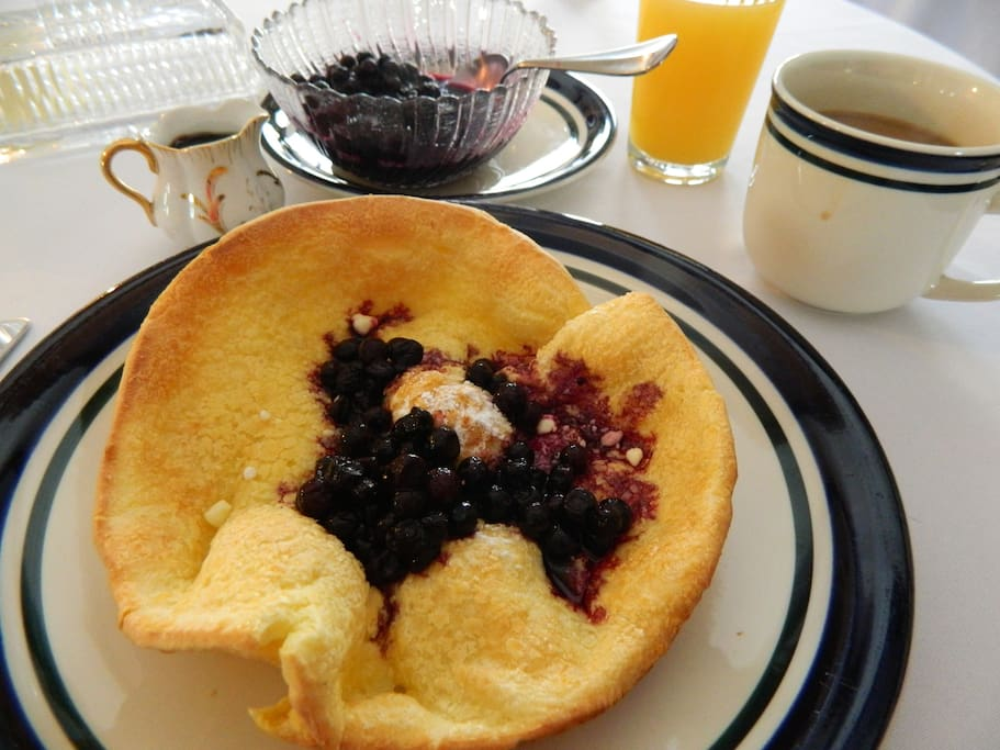 Delicious baked fluffy pancake with blueberries