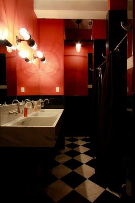 Shared bathroom has heated floors and Red Flower Organic products.