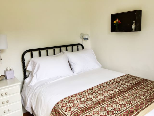 Bedroom #2, 100% cotton linens. 4 different pillows so you can find one that suits you. Reading lamps. Room darkening blinds and curtains. Personal fan. Extra blanket.