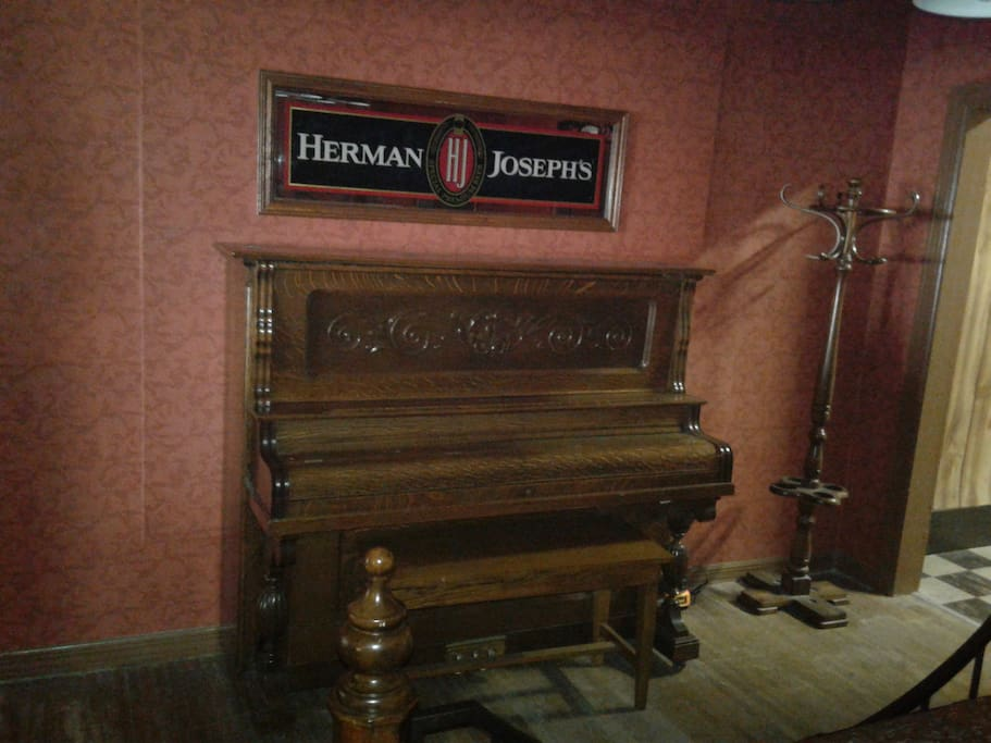 Store your valuables in the hidden compartments in this 100 year old prohibition piano.
