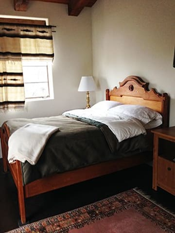 Guest room with full size bed, cable TV, plenty of closet and drawer space.