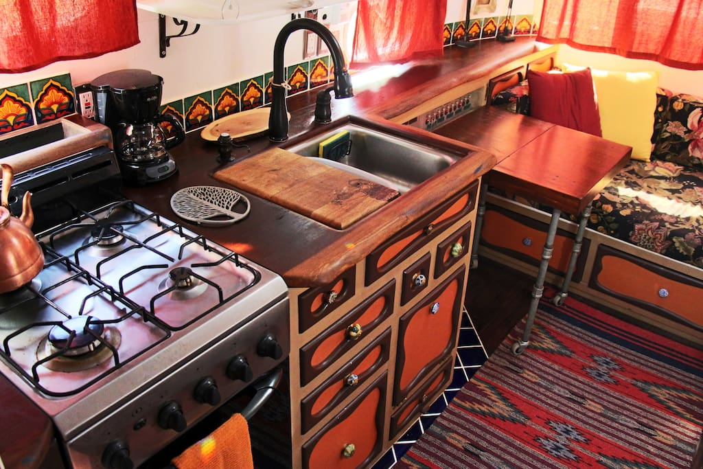 Four burner Gas stove and oven, large sink, coffee machine