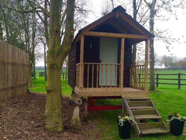 Shepherds hut retreat in quiet farm setting.
