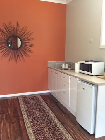 Funky kitchen diner with fridge, microwave cooker and toaster.