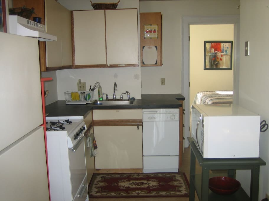 fully equipped kitchen. Dishwasher, gas stove, microwave, full fridge etc. Everu possible tool you could need