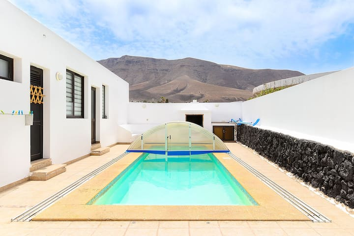 Famara Beach House on the Shore with Pool, Terrace, Gorgeous Ocean/Mountain Views & Wi-Fi; Parking Available, Pets Allowed