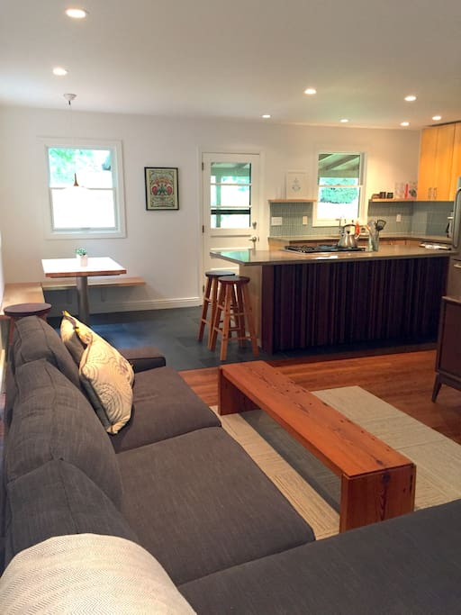 Open floor plan - Living/Dining/Kitchen and door to new back deck. Custom made dining & kitchen island.