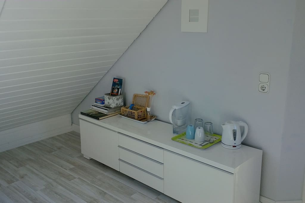 Small basic coffee, water and tea table. With additional storage space