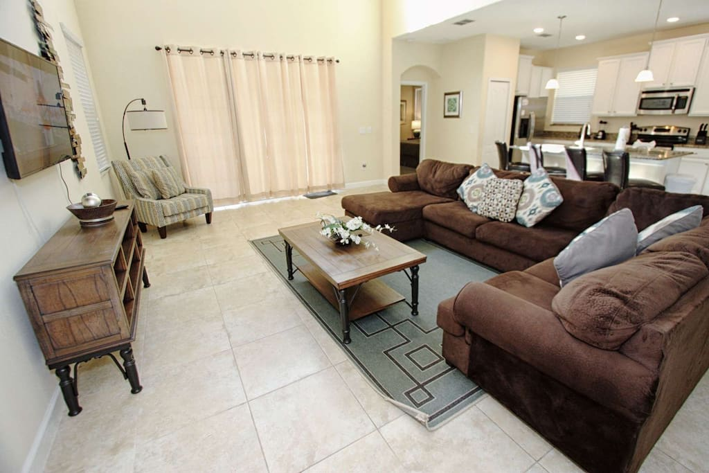 Open Floor Plan - Spacious Living Area w/Wall Mounted TV and Pool Area Access
