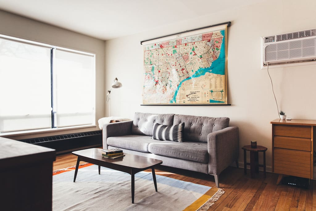 Our sun-filled little living room. Big original windows look out onto the street and the awesome homes of West Village.