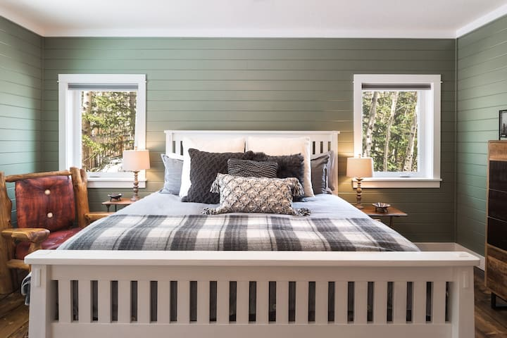 Snuggle up in the master bedroom's king sized bed with brand new pillow top mattress.