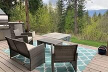 Sitting area on veranda and summer kitchen.
