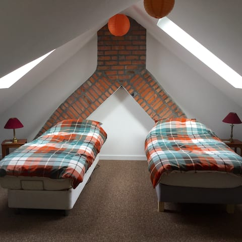 Twin room in family home