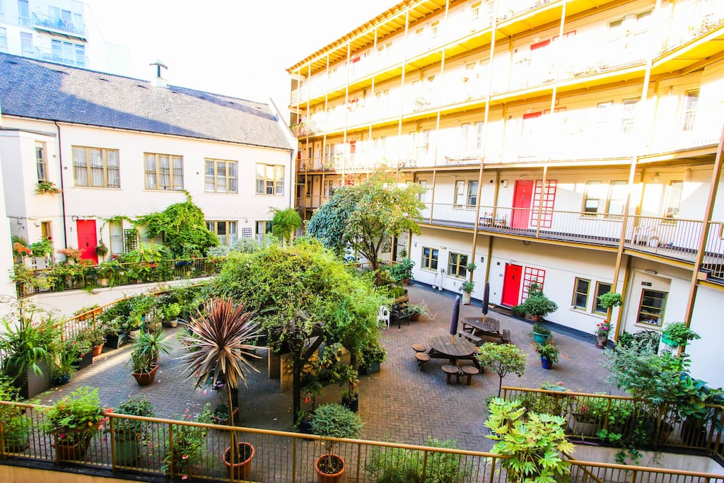The lovingly kept internal courtyard, for communal use. Features a BBQ which you can use too.