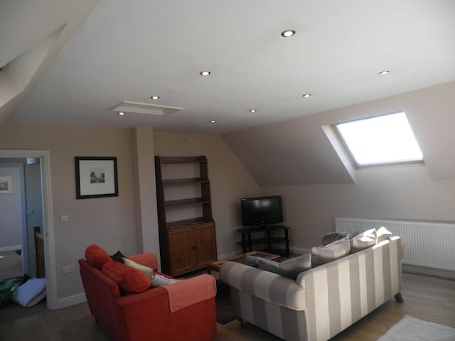 Large lounge  with Sofa bed available. T.V. additional dining area, 2 settees, free wi-fi.