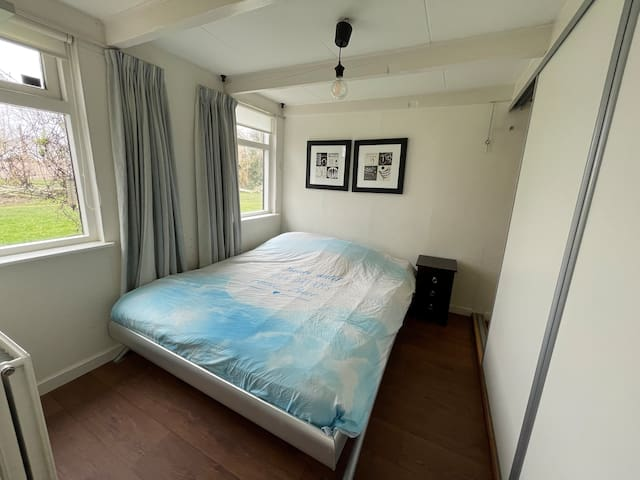 Double bed with the sliding door & also a closet inside