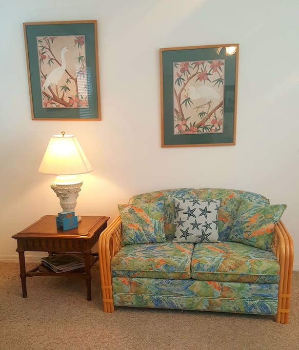 Cozy matching love seat. Great reading spot!