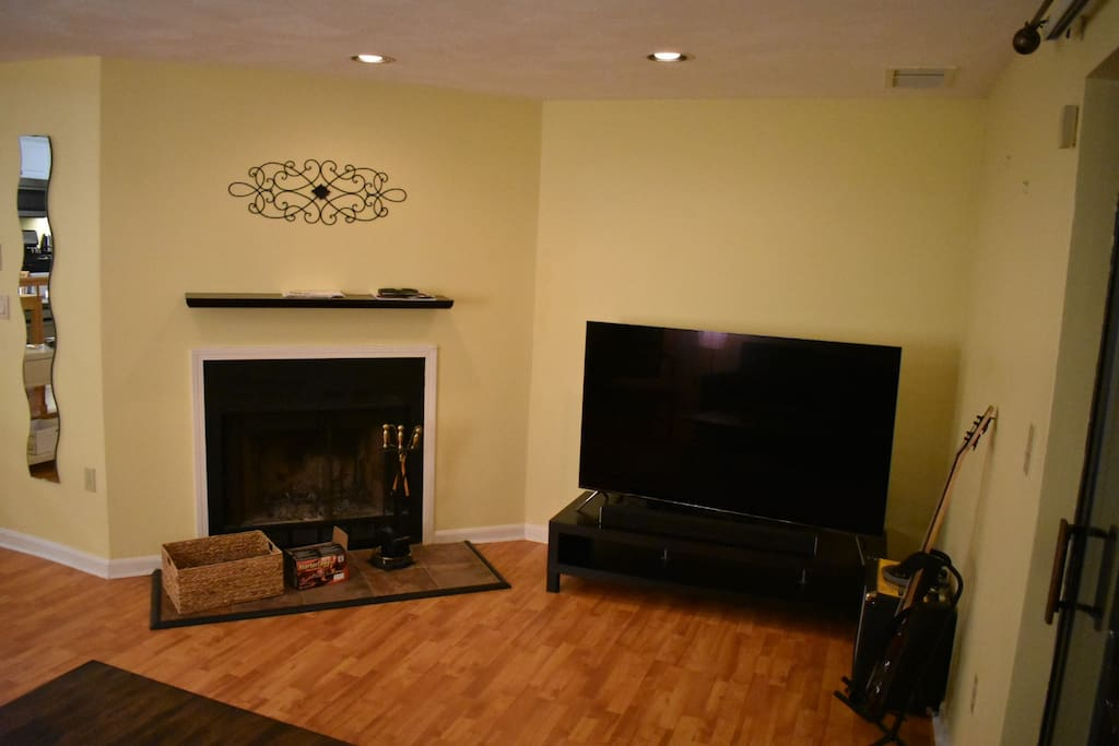 "65"" TV & Fireplace in living room"
