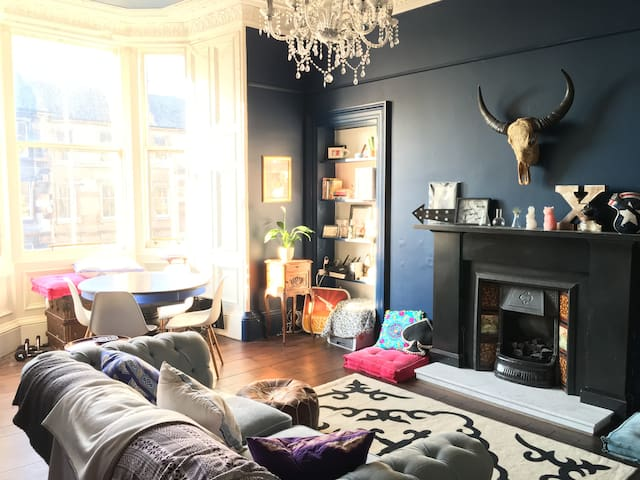 Our sitting room—huge, high ceilings, and a big bay window to let in lots of light.